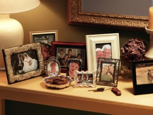 TS-78486658_collection-of-framed-pictures-on-console_s4x3.jpg.rend.hgtvcom.1280.960