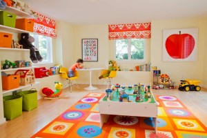 Geometric-and-floral-mat-in-brightly-colored-childs-playroom