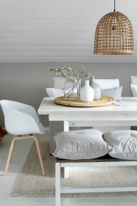 Casual-and-modern-dining-room-cushions-on-a-bench-white-dining-chairs-mix-in-natural-elements
